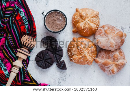 Pan de Muerto and hot chocolate, Mexican bread traditional for day of the Dead in Mexico Royalty-Free Stock Photo #1832391163