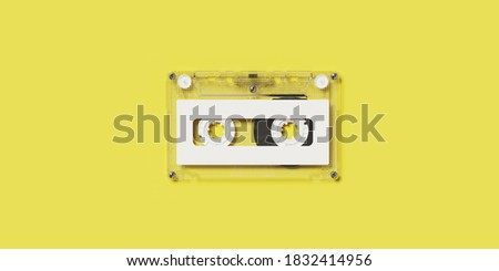 Minimal creative background for retro music technology concept. Clear cassette tape with white label on yellow background. 3d rendering illustration. Clipping path of each element included.