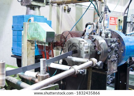 Rubber extruder is producing rubber profile Royalty-Free Stock Photo #1832435866