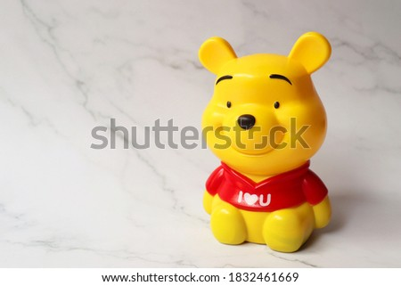 Yellow bear shaped piggy bank for kids. Save money banner. toy bear. bank for kids to save money.