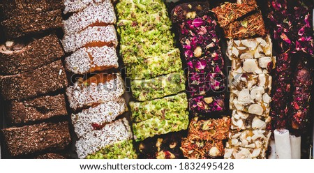 Variety of Turkish traditional lokum sweet delight wallpaper, texture, background. Middle East typical dessert Royalty-Free Stock Photo #1832495428