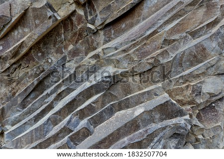 Various rock formation in geological layers in an abandoned quarry Royalty-Free Stock Photo #1832507704