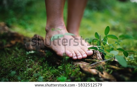 Bare feet of man standing barefoot outdoors in nature, grounding concept. Royalty-Free Stock Photo #1832512579