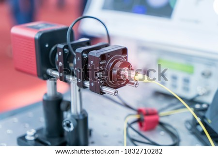 Experiment with laser device in optical laboratory #1832710282