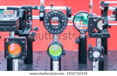 Experiment with laser device in optical laboratory #1832710318
