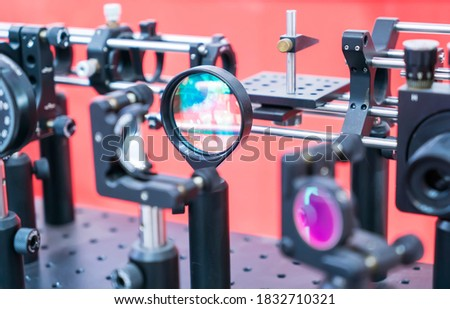 Experiment with laser device in optical laboratory #1832710321