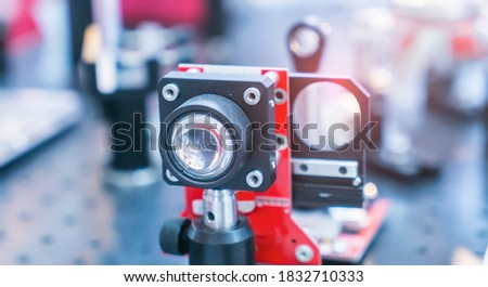 Experiment with laser device in optical laboratory #1832710333