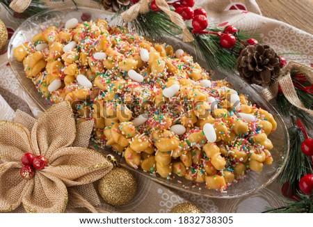 Neapolitan pastry called struffoli - Little shortcrust pastry balls fried dipped in honey #1832738305