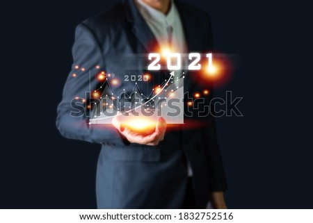 Plan business growth in year 2021 concept. Businessman plan and increase of positive indicators in his business, Growing up business concepts. Royalty-Free Stock Photo #1832752516