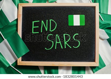 End SARS. Inscription of nigerian protest slogan. Royalty-Free Stock Photo #1832801443