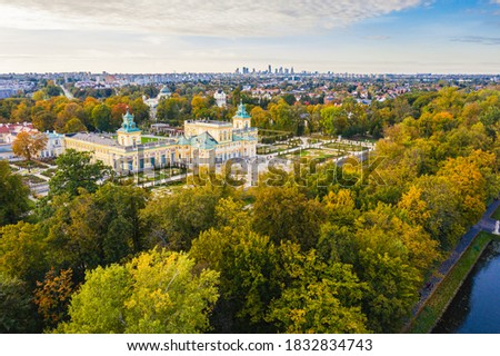 Autumn in Wilanow palace garden, Warsaw distant city center aerial view in the background Royalty-Free Stock Photo #1832834743