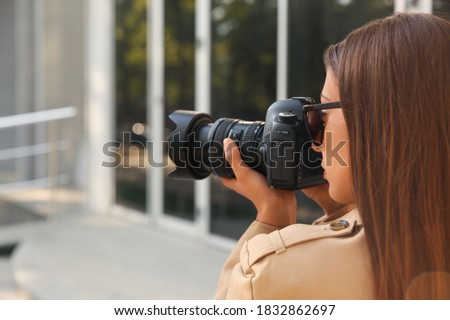 Private detective with camera spying on city street Royalty-Free Stock Photo #1832862697