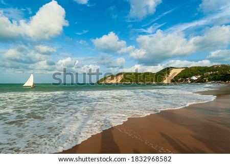 Ponta Negra beach, with Morro do Careca in the background, in the late afternoon, Natal, Rio Grande do Norte, Brazil on February 19, 2008. Royalty-Free Stock Photo #1832968582