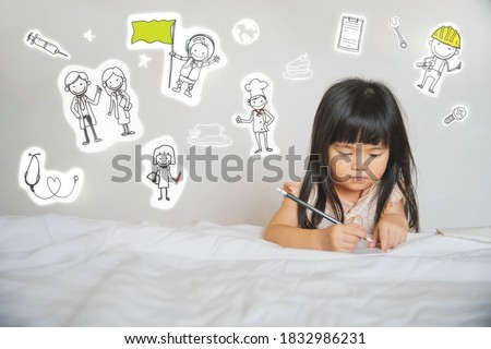 a little girl learning to write at home. Children Kids Dream Jobs Diversity Occupations Concept. Small kid and various drawings.