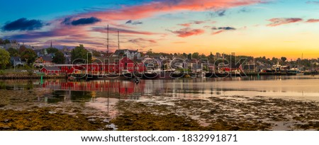 Lunenburg, Nova Scotia, Canada. Beautiful view of a historic port on the Atlantic Ocean Coast. Colorful Cloudy Sunrise Artistic Render. Panorama Royalty-Free Stock Photo #1832991871