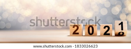 Wooden Blocks With 2020 2021 Number On Table  Royalty-Free Stock Photo #1833026623