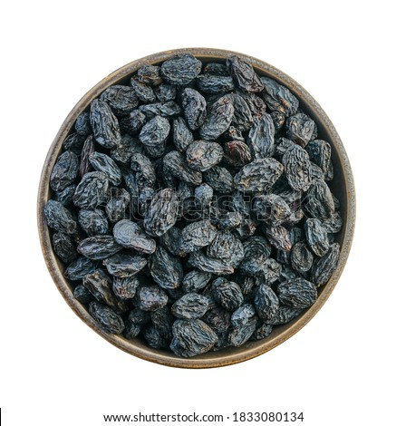 raisins in bowl with clipping path on a white background isolated                                Royalty-Free Stock Photo #1833080134