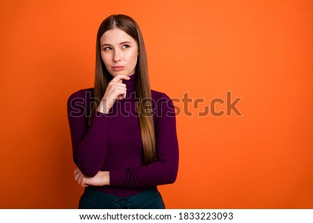 Photo of pensive minded girl touch chin hands look copyspace think thoughts ask answer difficult question wear pullover isolated over vibrant color background