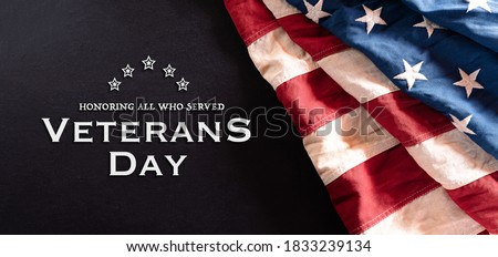 Happy Veterans Day concept. Vintage American flags against blackboard  background. November 11. #1833239134