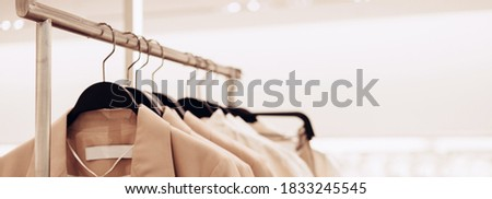 Hanger with women's clothing. Selective focus, copy space, banner format