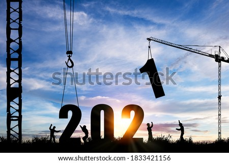 Silhouette of construction worker with crane under prepare welcome 2021 new year party and change new business.