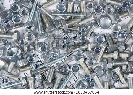 Hardware bolts and nuts top view background Royalty-Free Stock Photo #1833457054