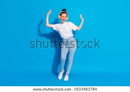 Full length body size view of her she nice attractive pretty dreamy cheerful cheery girl listening melody pop soul jazz bass having fun isolated on bright vivid sine vibrant blue color background Royalty-Free Stock Photo #1833483784