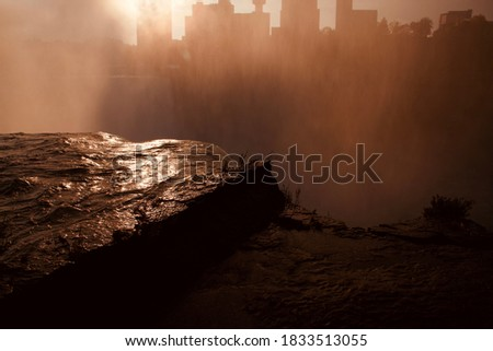 Rock and City skyline silhouette