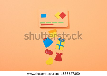 top view of credit card template near icons on peach background,stock image
