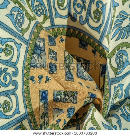 Silk fabric, royal monogram pattern, blue steel green brown on the fabric. your design will be imbued with the spirit of the Middle Ages. Textured background pattern