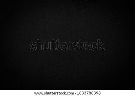 Beautiful Abstract Grunge Decorative Navy Black Dark Stucco Wall Background. Image of the dark colored concrete wall has light from the center of the picture. There is space for designing and text.