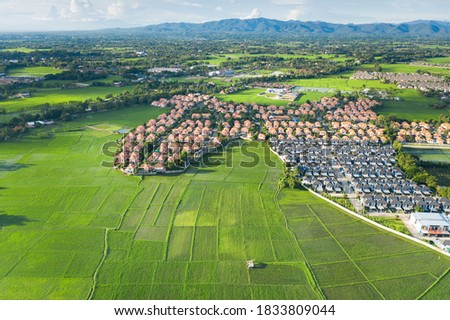 Housing subdivision or housing development. Also call tract housing. Large tract of land that divided into smaller. Business process by developer and builder. Aerial view in Chiang Mai of Thailand. Royalty-Free Stock Photo #1833809044