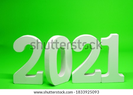 Happy new year 2021 , 2021 number wooden object on green background and copy space - green new year celebrate concept  #1833925093