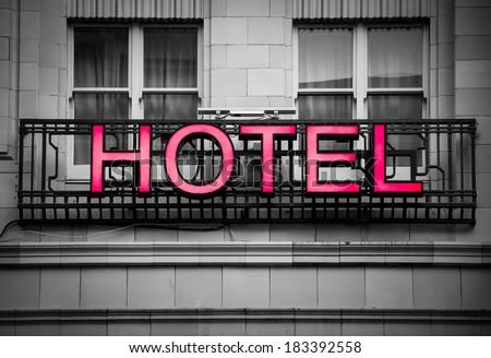 hotel signboard in a building facade