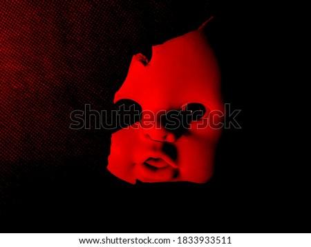 half broken doll face under red and black lighting #1833933511