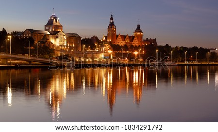 Szczecin. After dusk. A view of the Odra River and the historic part of the city, called the Chrobry Embankments. Poland Royalty-Free Stock Photo #1834291792