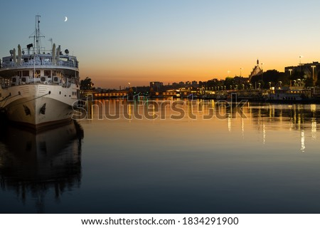Szczecin. After dusk. View of the river and ships and the historic part of the city, Poland Royalty-Free Stock Photo #1834291900