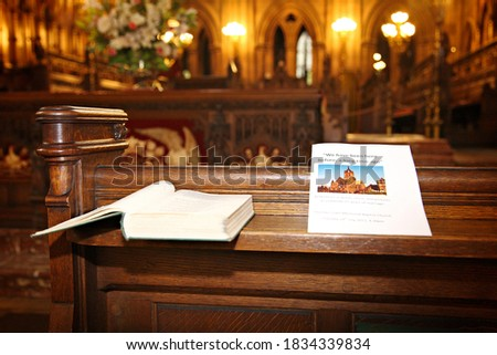anniversary event programme resting on the church pew with picture of coats memorial church in Paisley in Scotland.