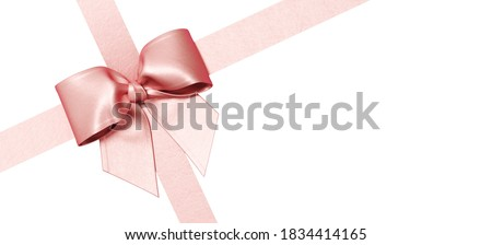 Minimal copy space for Christmas, New year and holiday season. Pink ribbon bow isolate on white background. 3d render illustration. Clipping path of each element included.