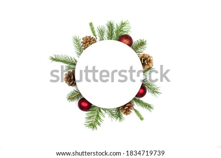 Christmas round frame mockup made of spruce branches, red decorations, fir cones flat lay isolated on white background, copy space. Christmas composition with wreath top view. Xmas celebration Royalty-Free Stock Photo #1834719739