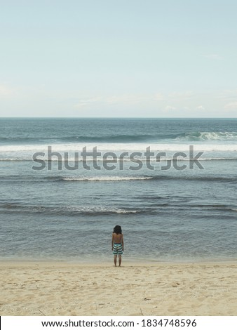 A man alone in front of the sea in Pacitan #1834748596
