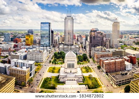 Aerial view of Indianapolis, Indiana skyline above Indiana World War Memorial and University park, and along Meridian and Pennsylvania streets.