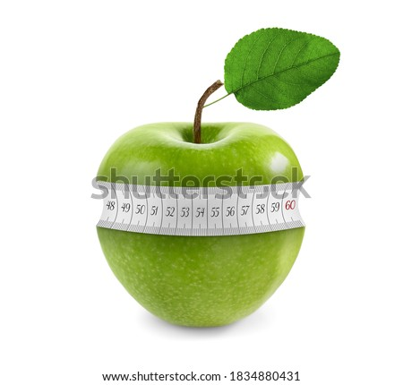 Green apple with measuring tape on white background. Slimming, weight loss concept Royalty-Free Stock Photo #1834880431