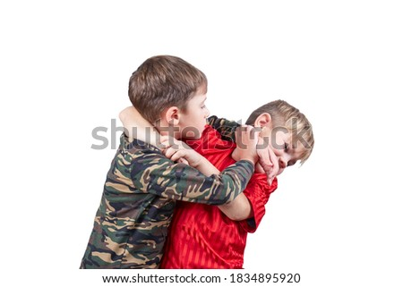 Two boy athlete performing grip release technique on white isolated background Royalty-Free Stock Photo #1834895920
