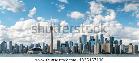 Panoramic view of Toronto skyline and Lake Ontario on a sunny day, Toronto, Ontario, Canada.  Royalty-Free Stock Photo #1835157190