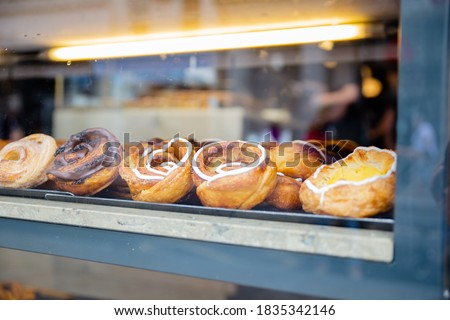 Picture of Chocolate and Cream Danish pastries Through the glass of a Window from a bakery