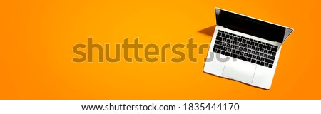 Laptop computer with shadow from above - overhead view Royalty-Free Stock Photo #1835444170