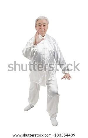 Senior man doing Tai Chi #183554489