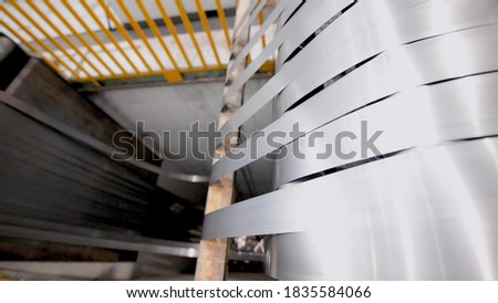 Rolled steel. Stack of rolls, cold rolled steel coils in action. Galvanized steel sheet and rusted edge. Cold rolled steel coils. Drum turns sheets into production. Industrial #1835584066