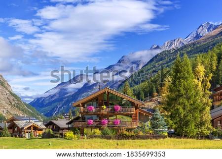 Zermatt, Switzerland, Swiss Alps alpine village, mountain peaks panorama, houses decorated with flowers Royalty-Free Stock Photo #1835699353